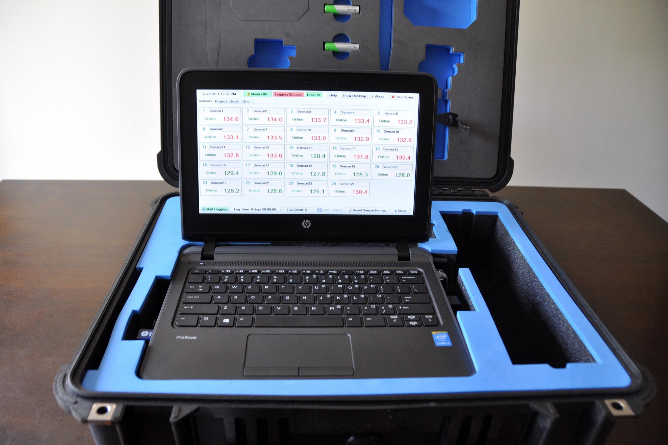 A laptop sits inside in it's case