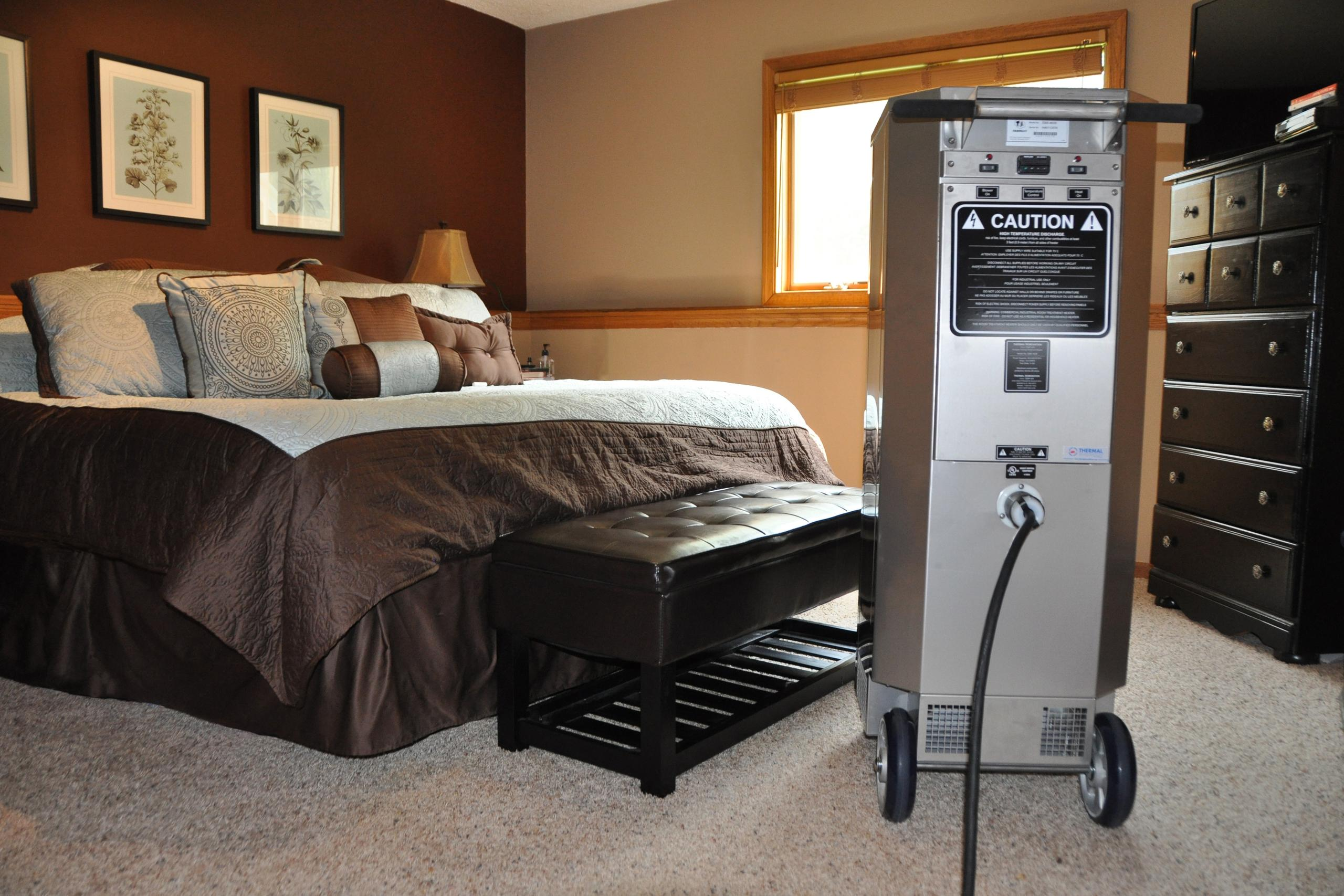 Bed bug heat equipment sits ready for use inside a bedroom