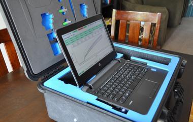 A laptop sits insdie a suitcase