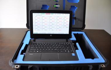 A laptop sits inside it's case